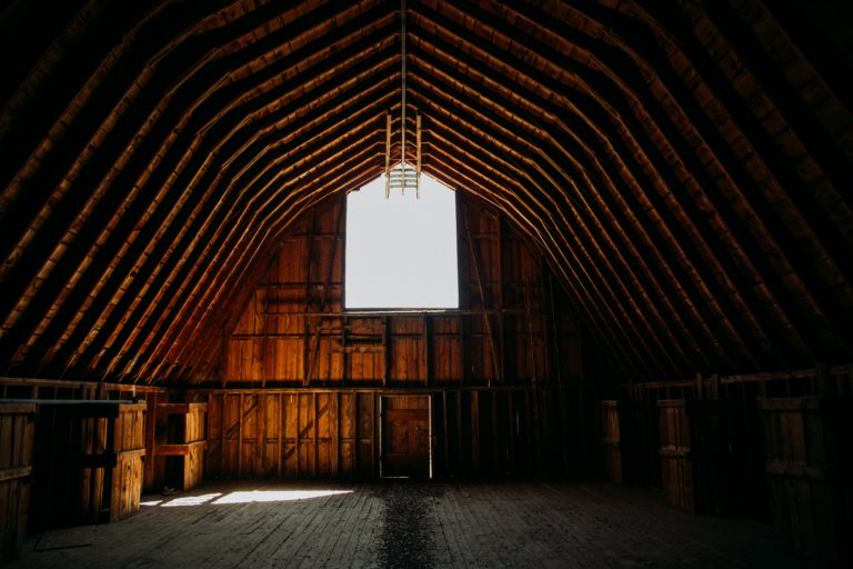 picture of an empty pole barn with a window