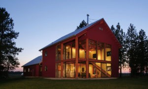 lighted red pole barn house